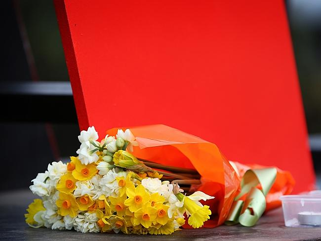 Melburnians begin to leave floral tributes to those lost aboard MH17.
