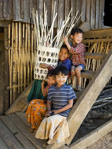 Children playing with woven basket.