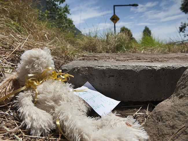 A soft toy is left at the site beside the M7 in Quakers Hill where the newborn was found