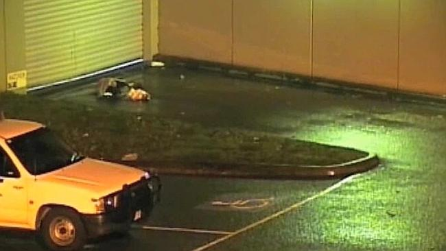 Gong Ling Tang is seen lying on the road after he was left outside of Dandenong police st