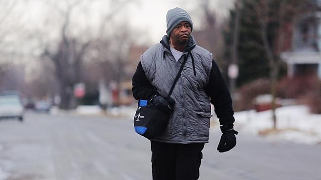 Tireless worker ... James Robertson walks to catch his morning bus as a part of his epic