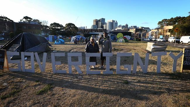 Lizzy Davis and Joe Miles at the tent embassy site near Redfern in Sydney. Picture: John