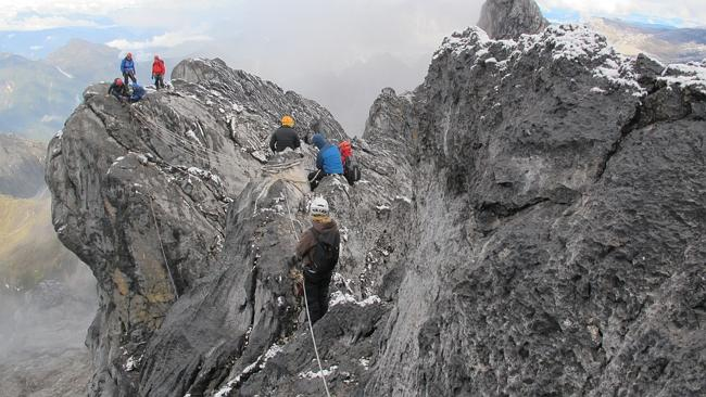 Luke Richmond and his fellow mountaineers on their to the top of Carstensz Pyramid.
