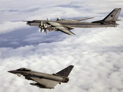 Bear on the prowl ... A British Typhoon fighter escorts a Russian Bear bomber last year.