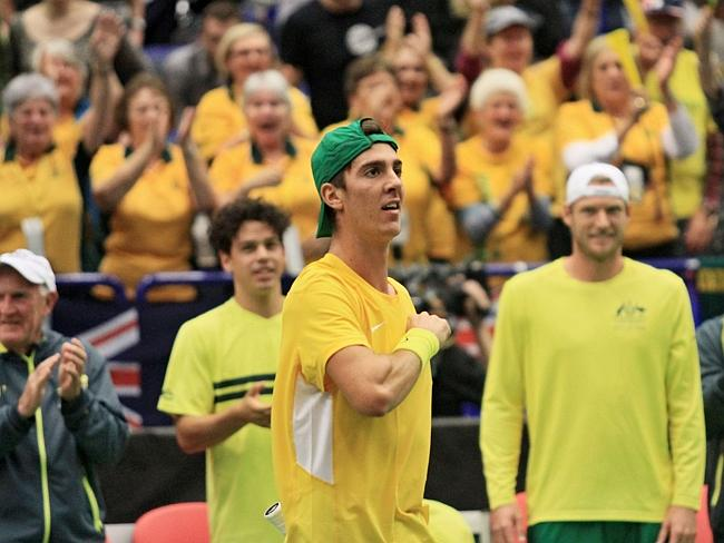 Kokkinakis pounds his chest after completing an incredible comeback victory against Lukas