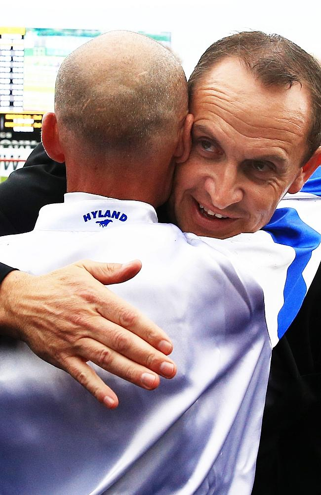 Well done, mate: Glen Boss hugs trainer Chris Waller. Picture: Mark Evans