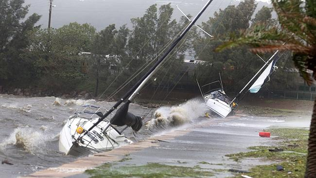 Yachts washed up on Gosford waterfront in rough seas. Picture: Mark Scott