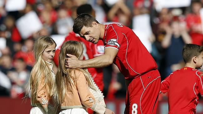 Gerrard greets his daughters as they join him on the pitch ahead of the game.