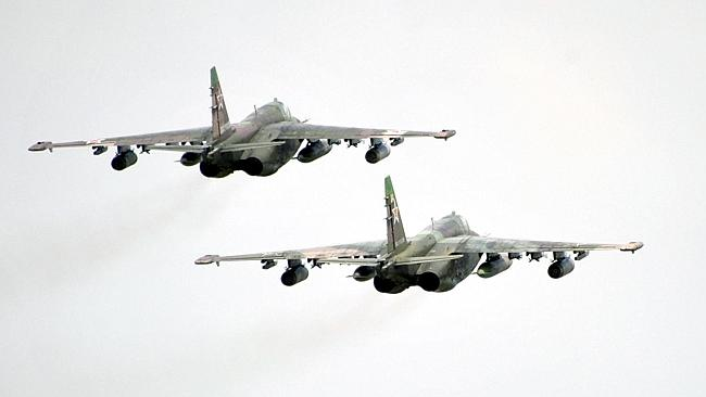 That's too close ... Russian Army Su-25 jet fighters fly near the Baikal Lake in Russia i