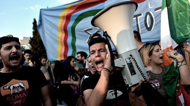 On tenterhooks ... Protesters have demonstrated in front of the Greek parliament in Athen