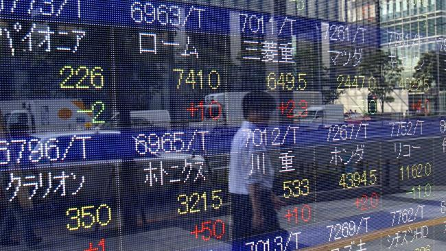 Global stocks and Asian currencies fell Tuesday after China unexpectedly devalued its yua