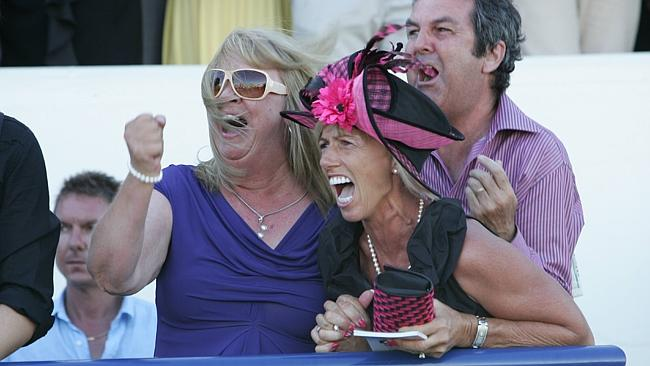Gillian Heinrich watches as Military Rose wins the Magic Millions 2YO Classic in 2010.