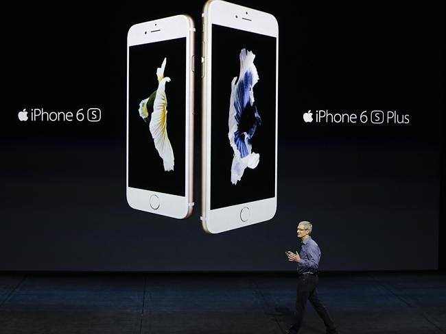Apple CEO Tim Cook shows off the iPhone 6s and iPhone 6s Plus