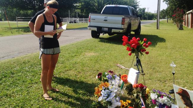 Sarah Harper next to a memorial along the road where Chris Lane was killed. Picture: AP