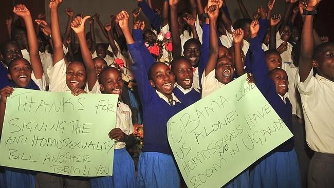 Ugandan pupils take part in an event organised by born-again Christians to celebrate the