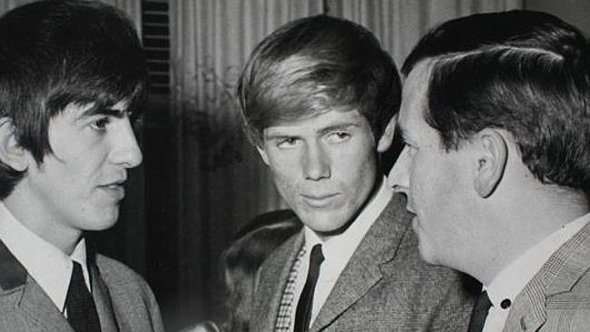 Adelaide artist Peter Findlay (centre), with Beatle George Harrison (left) and media pers