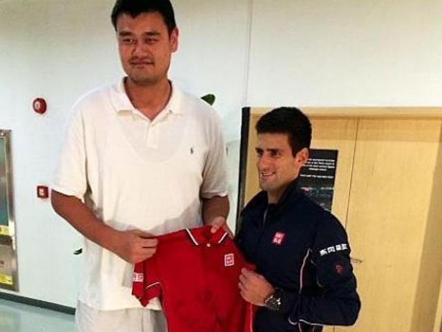 There's no way Yao is fitting into that shirt.