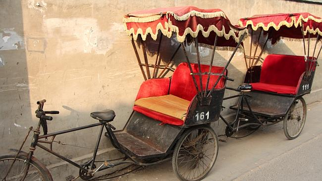 Rickshaws wait to carry passengers through the labyrinth of Hutong lanes. Picture: Sarah