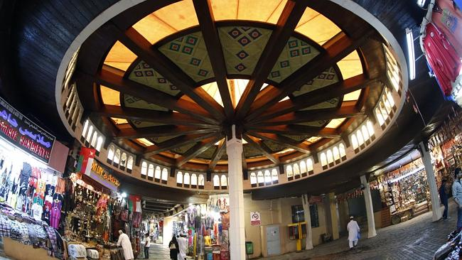 Omani walk past market stalls in the capital Muscat.