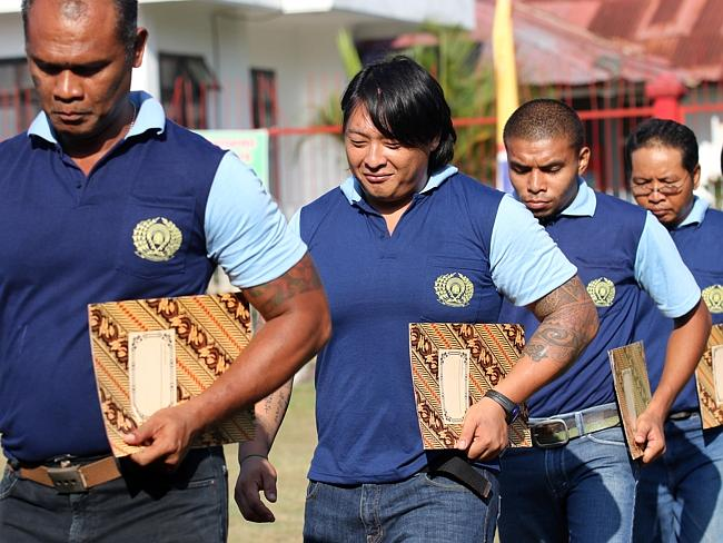 Andrew Chan (second from front) lines up with other inmates last year.