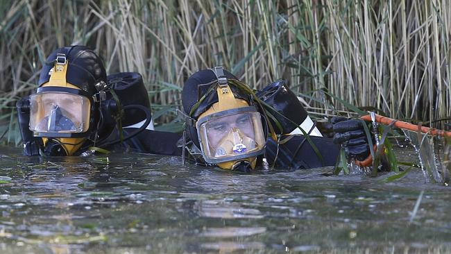 Police divers search an irrigation channel. Picture: AAP/David Moir