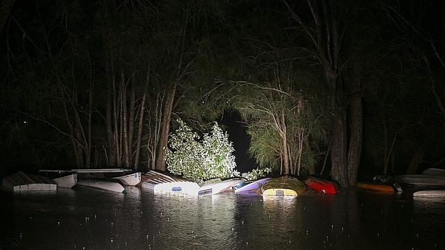 The hulls of upturned submerged boats sit in a flooded reserve in Narrabeen. Picture: Chr