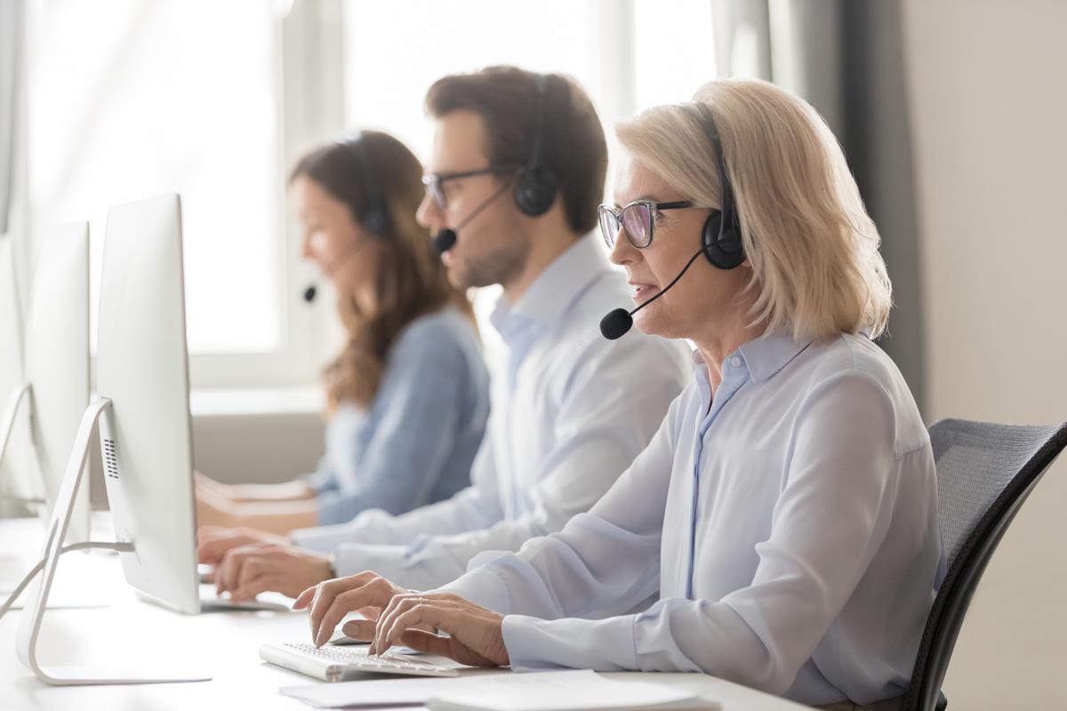 Call center employees at desks