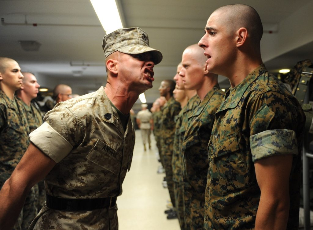 drill sergeant giving orders to soldier