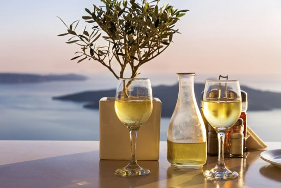 Romantic table for two on the island Santorini, Greece. Views of the sea and the volcano