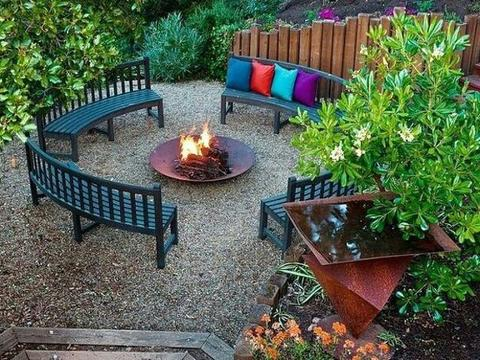 Round fire pit with curved bench