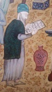 Detail - Iraans figuur met kalligrafie