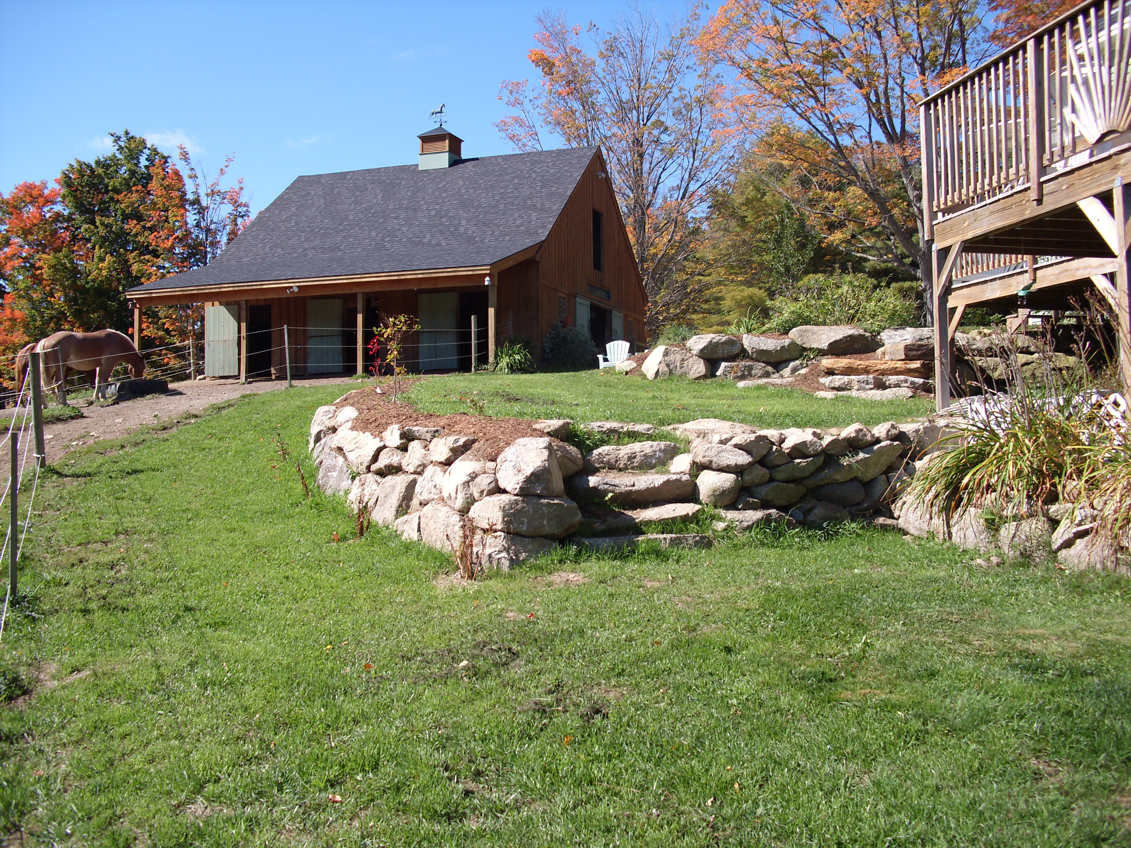 New landscaping this year.  Kevin Roberts built us a wall and some steps...all the stones came from our property.  Gotta love living in the granite state!
