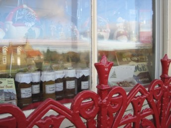 Striking red metalwork on this tearoom windowsill.