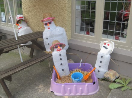 Snowmen at the beach- that's definitely madness!