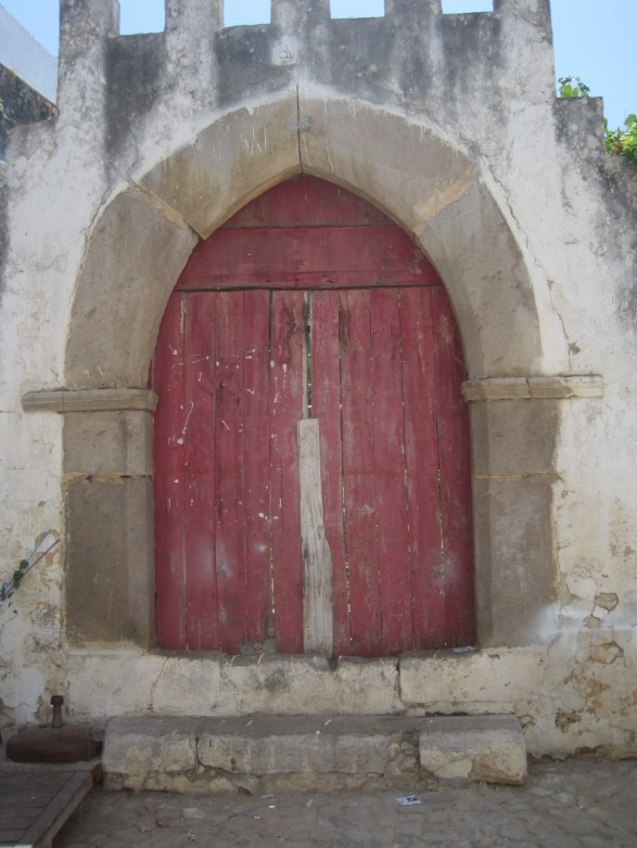 Got to squeeze in a battered old red Tavira door.