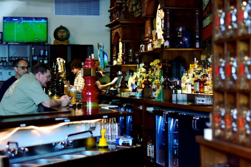 The bar at The Radler in Chicago's Logan Square, with owner Adam Hebert pouring a draft in background/Photo: Kristine Sherred