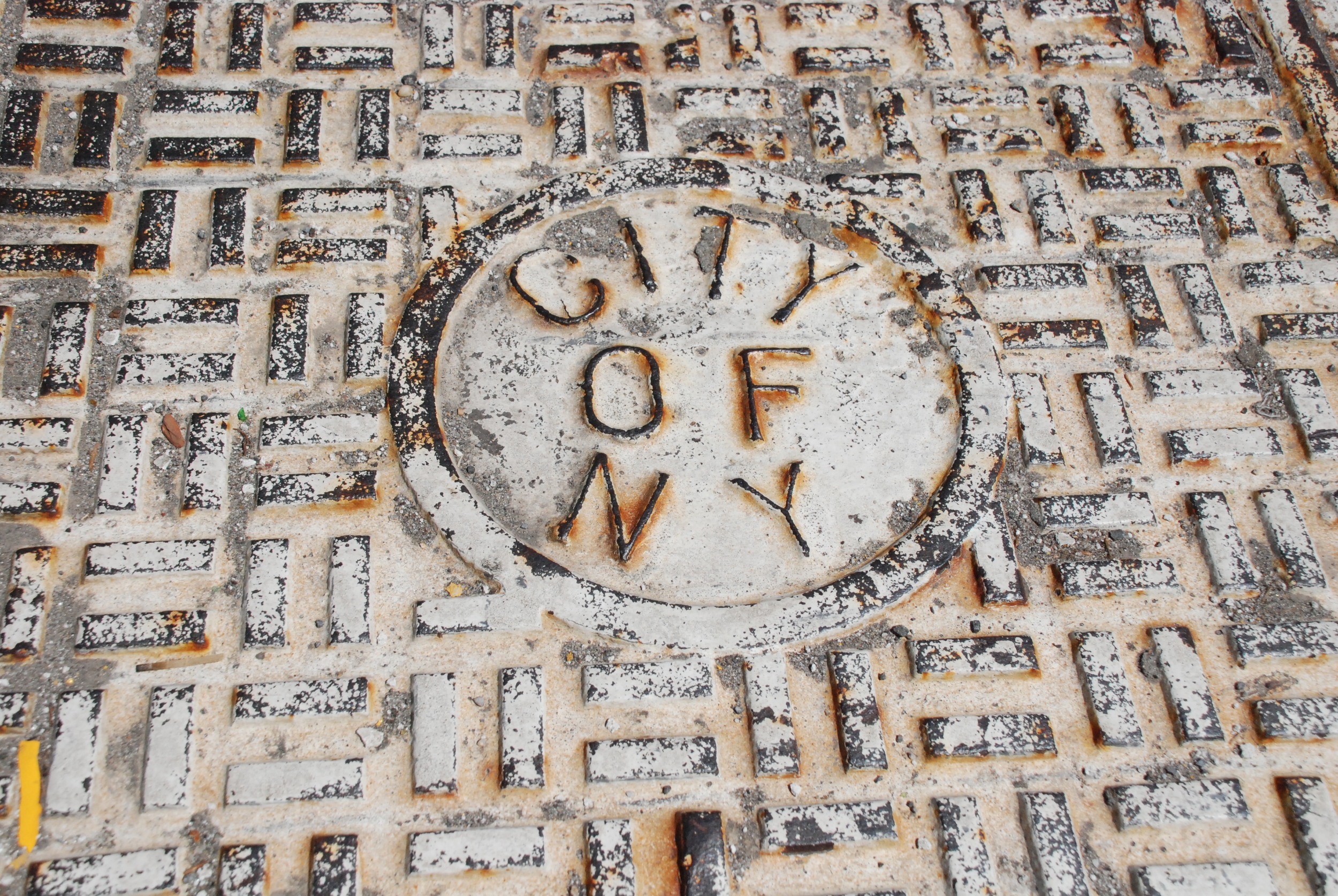"""Sewer cover that says """"City of New York"""""""