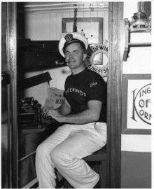 Stan Allyn aboard the Kingfisher. Allyn was also a maritime writer and, for a time, a coastal correspondent for the Oregonian.  Supposedly he did much of his writing aboard the Kingfisher. This photo is LCHS #2695 (Image courtesy of Lincoln County Historical Society)
