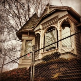 The 1884 Bridges House in Portland isprepared for demolition in this January 24,2014, photo. Despite being listed in theHistoric Resources Inventory and cited as aprime example of the Eastlake Style in ClassicHouses of Portland, the house had no formalprotection to slow or stop the demolition permitrequest (Restore Oregon Instagram photo).