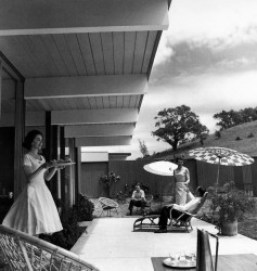1950's couples enjoying a drink on a patio