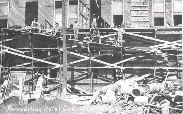 workers on wooden scaffolding during 1910 reconstruction of the Julian Hotel