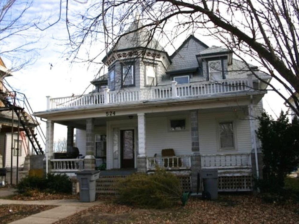 2007. Bob has much improved the carriage house. Note the two new porch columns. Note also the front railings; these date from the 1894 carriage house porches.