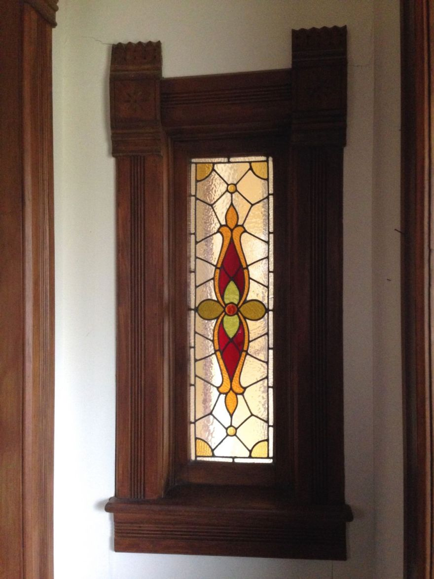 To each side of the vestibule are a pair of typically Squires-like stained-glass windows.