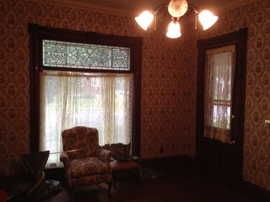 You step from the living room (parlor) into another, well, living room. There are three main rooms in a east/west line: Living room, second living room, and dining room.