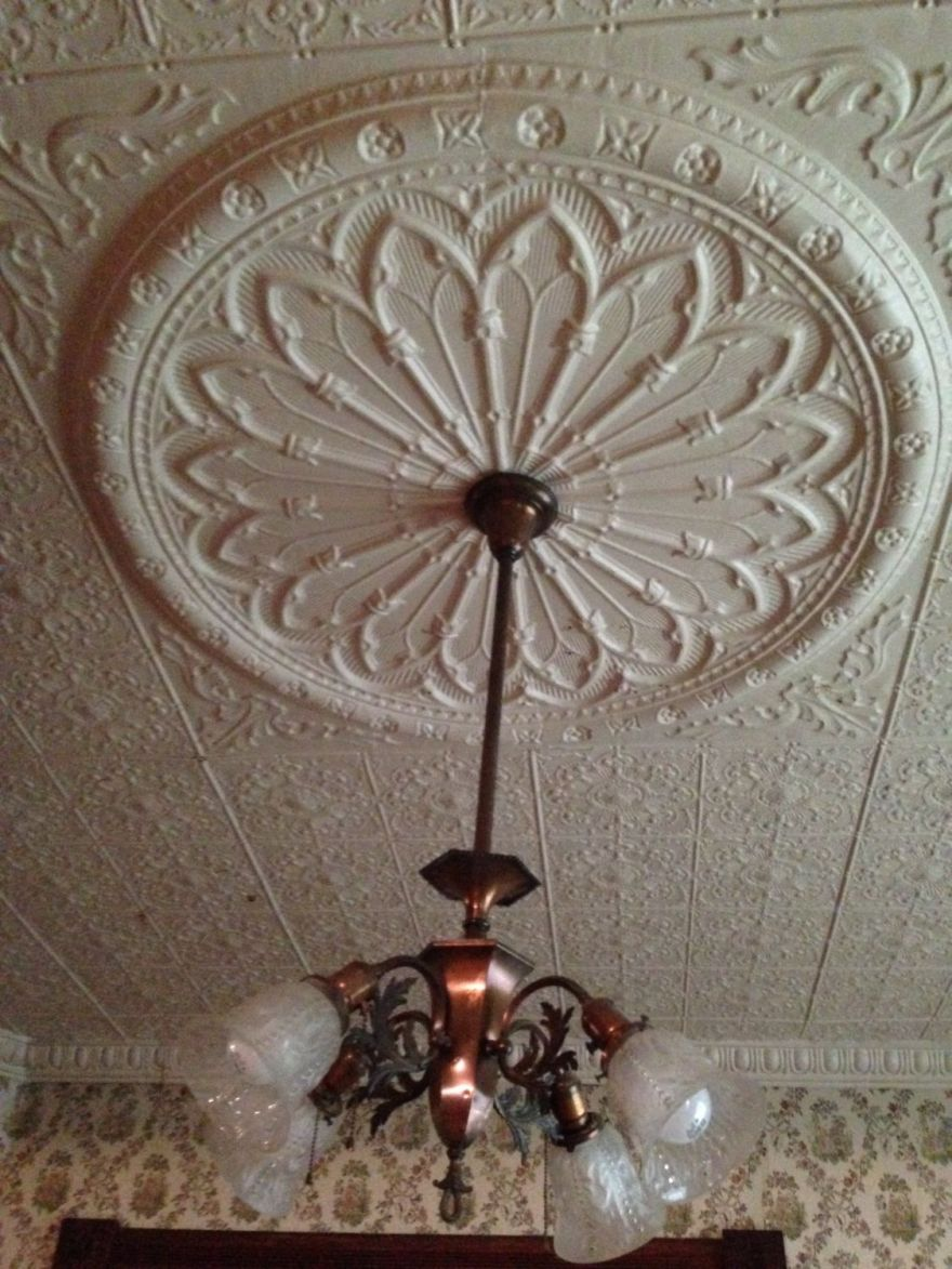The chandeliers of the three main rooms match. I do not think the shades are vintage.