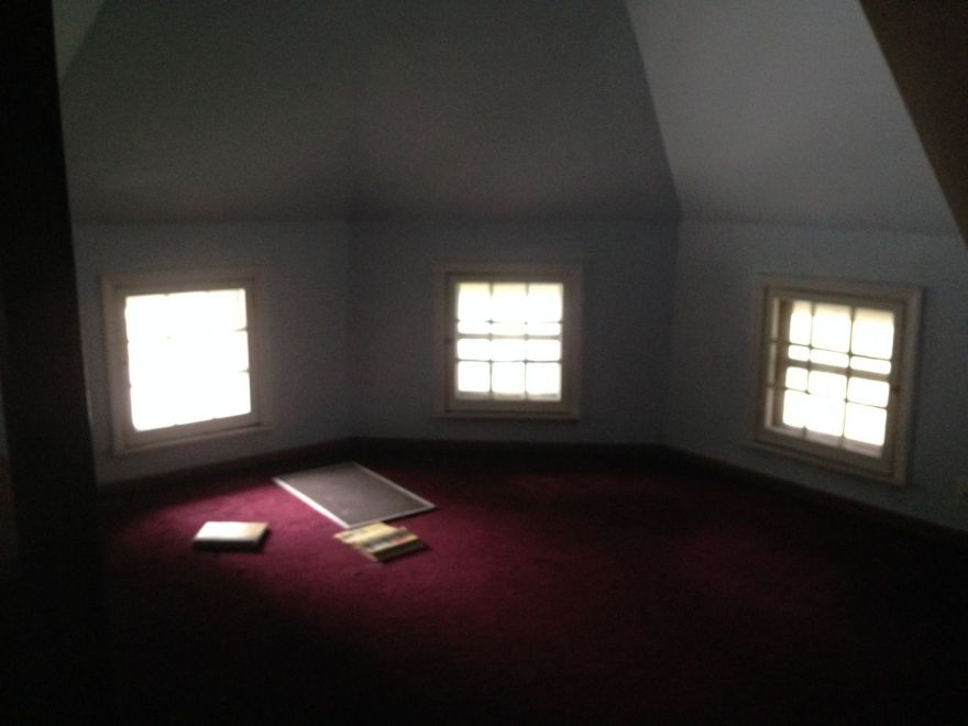 When you get (squeeze) upstairs, you find a single room, and all recently sheetrocked. Does the original wall surface remain hidden under????? The windows are all original.