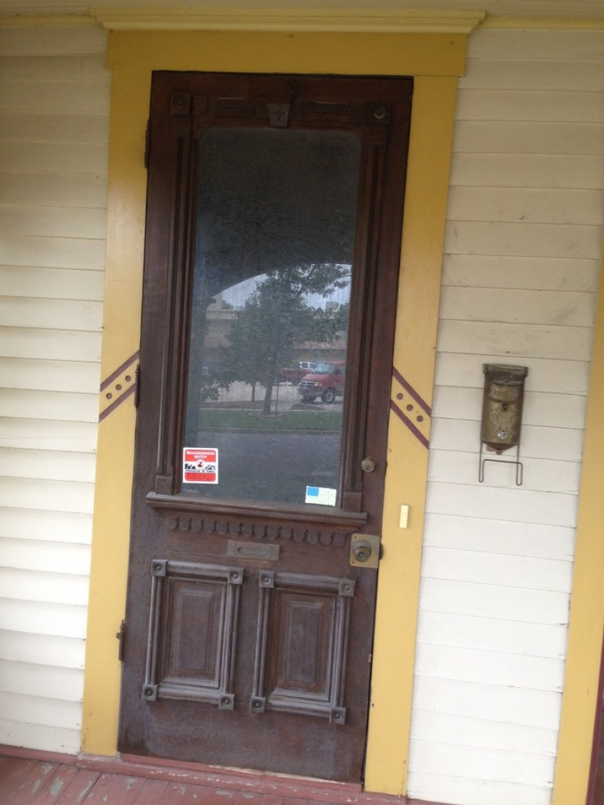 Front door. The glass is textured.