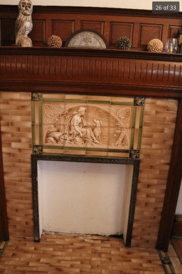 This image is from the real-estate listing. Sadly, they did not show the full mantle. However, the tile is by the American Encaustic Tiling Company, as is all the tiling in the Cross House.