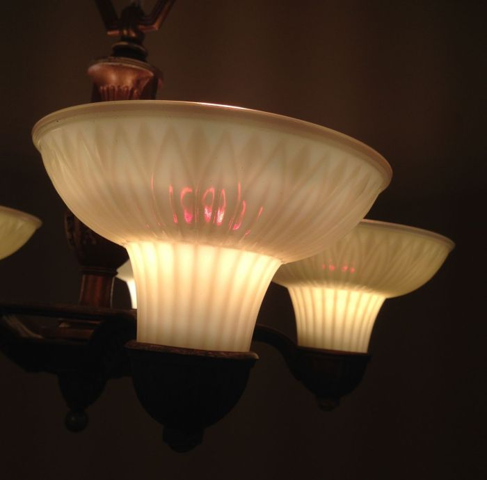 When the fixture is not lighted the shades appear to be normal custard glass. But at night, when lighted? Wow. Wow! The shades became sorta translucent, and with a stunning iridescent quality. My images simply cannot capture the effect which is amazing in person.