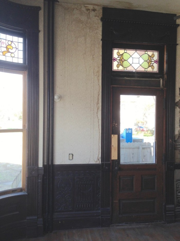 The door. It had obviously been cut down top/bottom, and awkwardly fitted into what was originally a window.